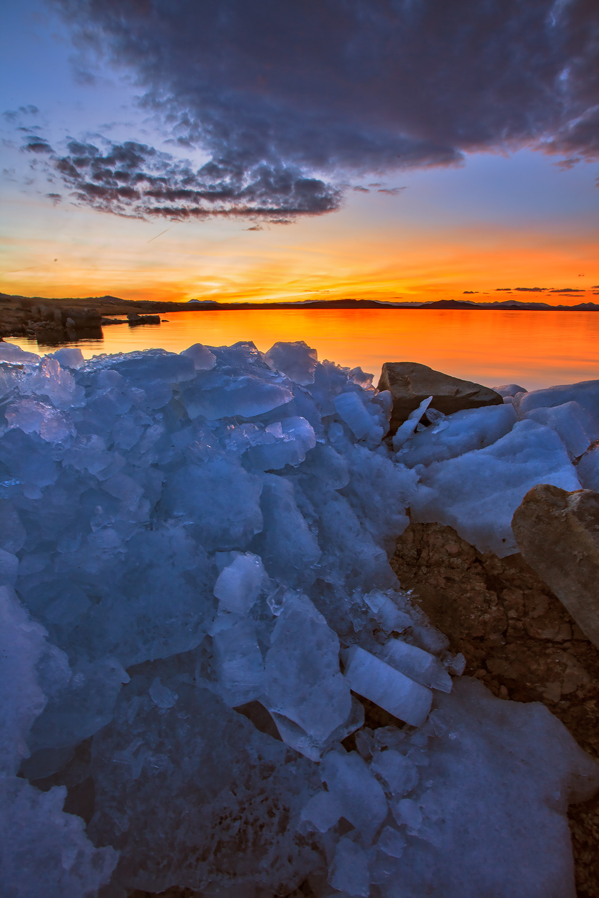 Sunset from the icy shore of Eleven Mile Reservoir.