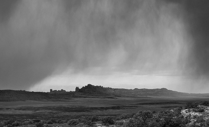 Showers approach from the West in Arches National Park.