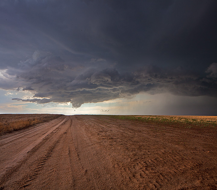 Thunderstorm and wall cloud on a deserted road in eastern Colorado