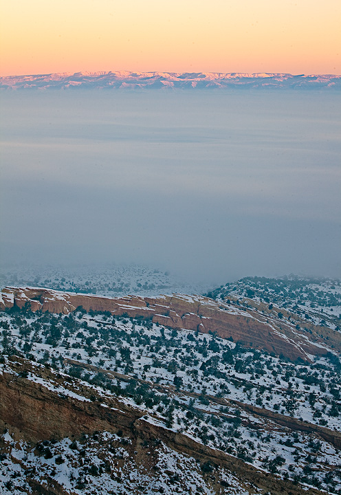 Layers of fog, canyon and distant mountains.