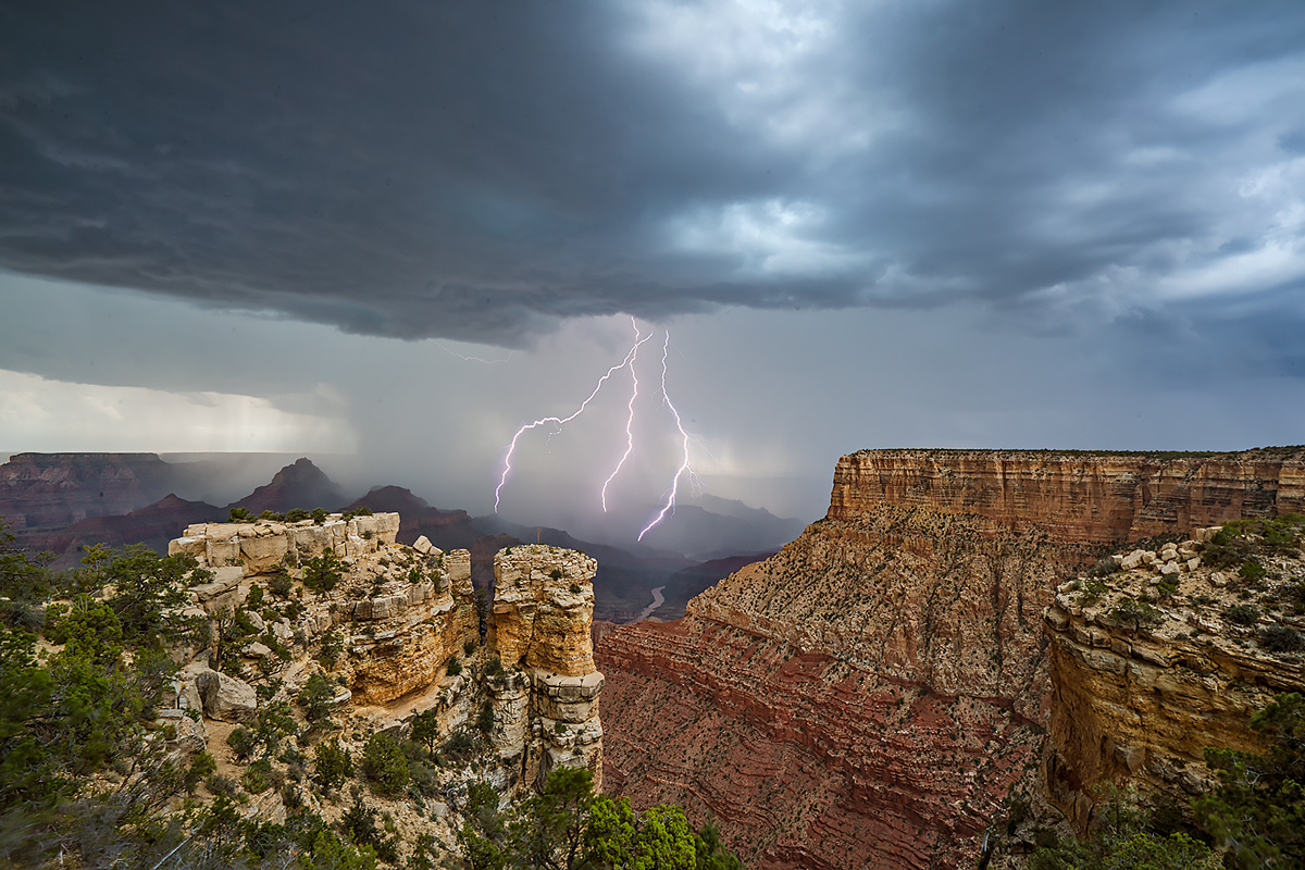 A trio of lightning strikes over the south rim of the Grand Canyon during a severe thunderstorm.