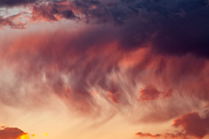 Virga and the setting sun combine to make an abstract painting in the sky.