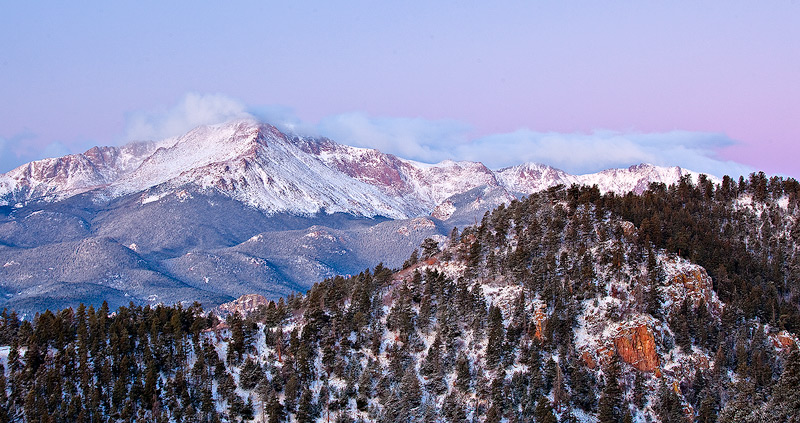 Pre-sunrise glow on Pikes Peak after an overnight snowfall.