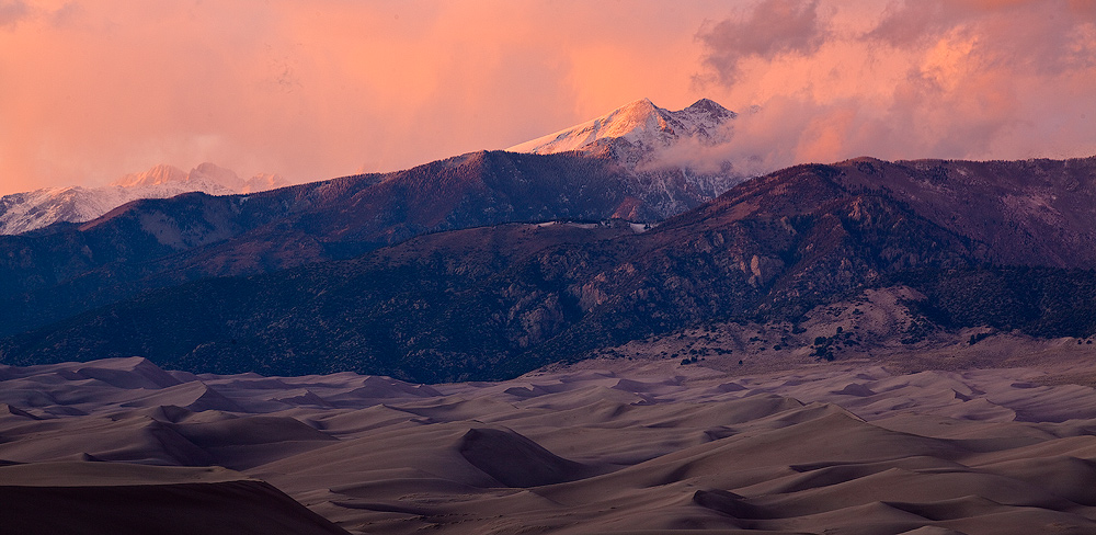 Magnificent sunset from the high dunes; Cleveland Peak on right; 14,000+ foot Crestones on left.