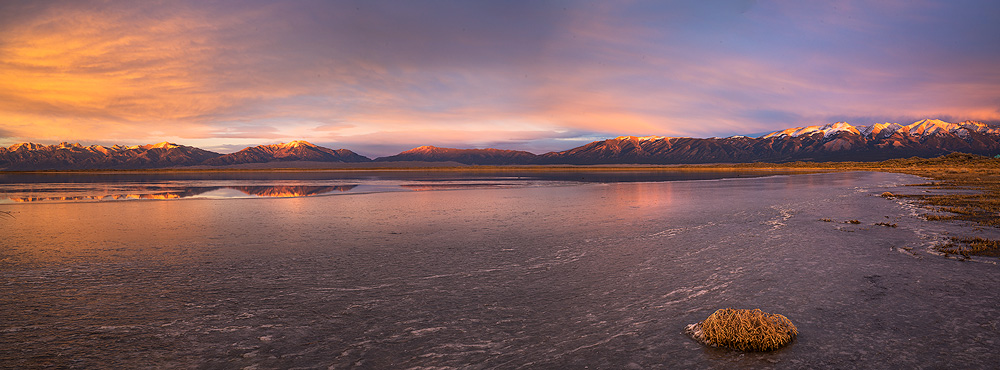 Sunset from a frozen San Luis Lake, looking across to the Great Sand Dunes and Sangre De Cristo Mountains.