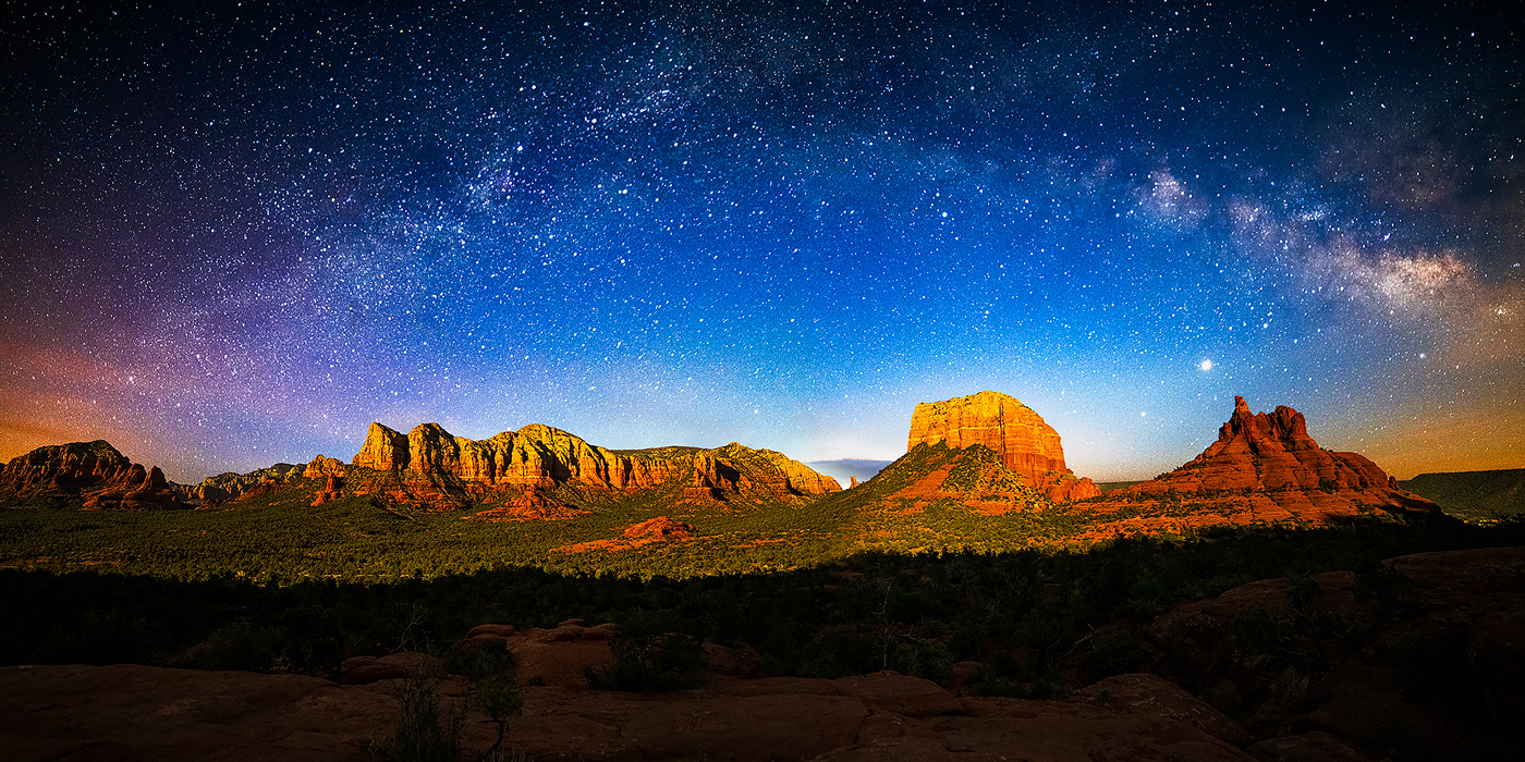 The Milky Way rising over the Munds Mountain Wilderness east of Sedona, as the landscape is lit by the nearly full moon setting...