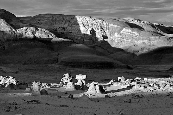 Strange rock formations in the Bisti Badlands as the sun rises.