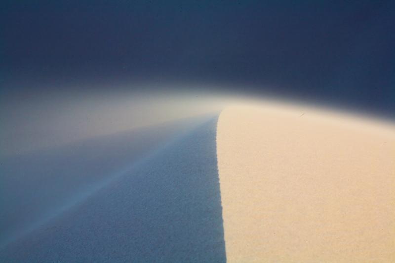 Sand blows off a dune crest.
