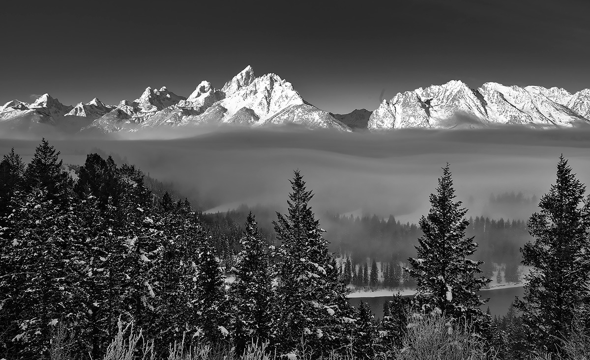 Fog rolls down the Snake River Valley as seen from the Snake River Overlook, a spot made famous by Ansel Adams.