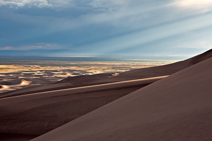 Crepuscular Rays from the late afternoon sun match the angles of the dunes.
