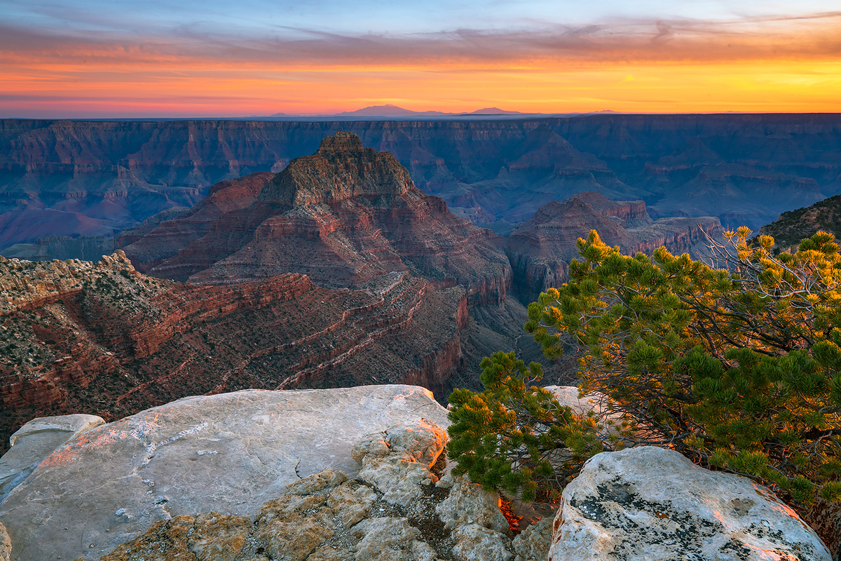 Last light hits the north rim of the Grand Canyon at Cape Royal