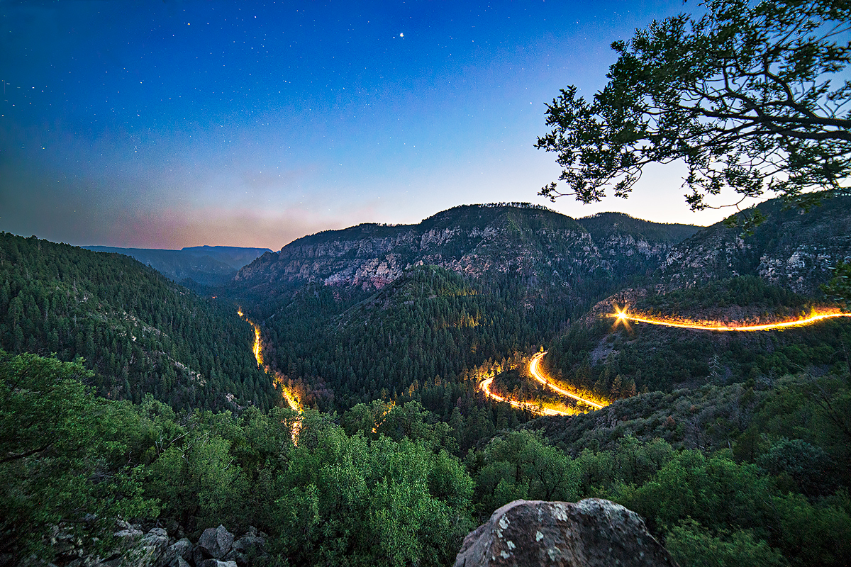 Car lights illuminate the switchbacks in a long exposure from the Oak Creek Vista.