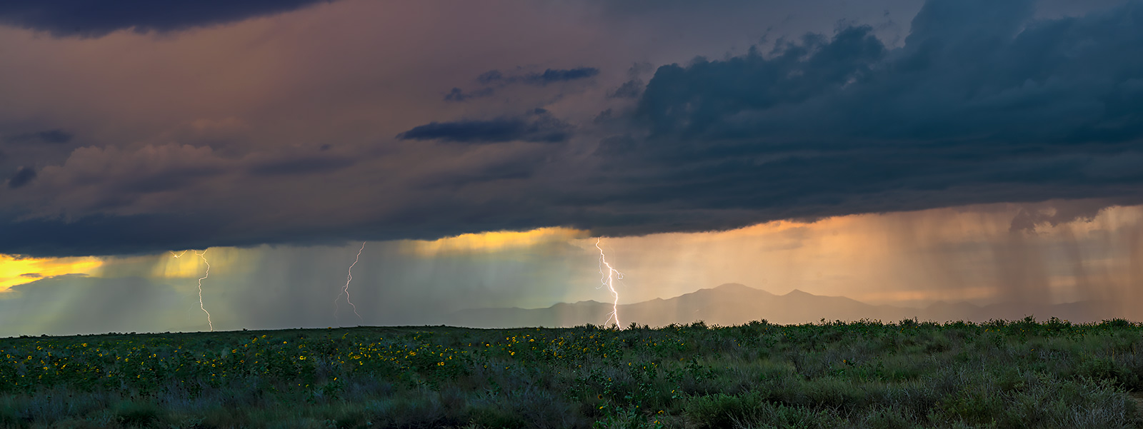 Lighting from storm at sunset south of Pikes Peak,