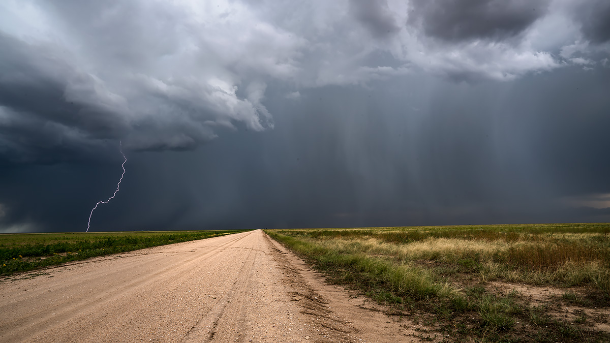 Thunderstorm and lightning on a remote road in southeast Colorado.