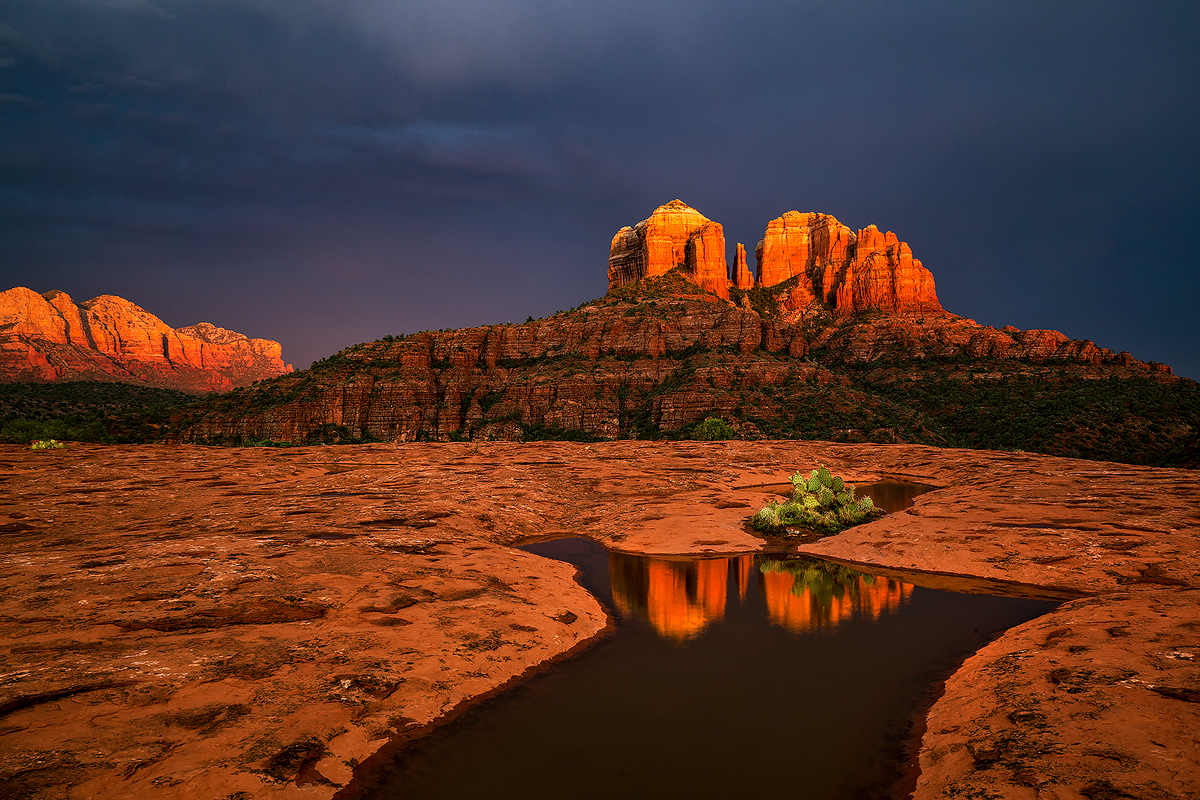 Vivid monsoonal light before sunset dramatizes the red rocks overlooking Cathedral Rock in Sedona.
