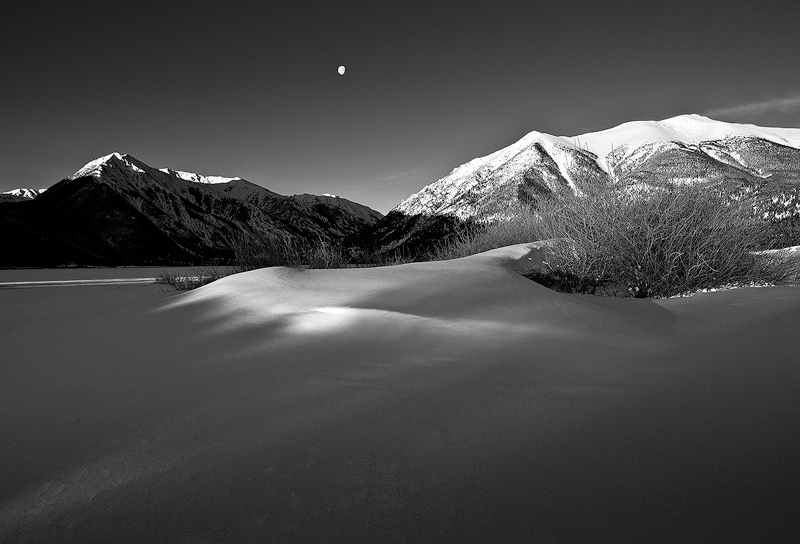 First light of the morning illuminates a snow drift, with Mount Elbert and the setting moon behind. Achilly minus 5 degree...